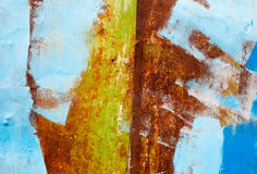 Rusty metal surface painted with multicolored paint. Abstract background Royalty Free Stock Images