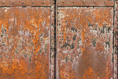 Rusty metal surface with rivets and joints Royalty Free Stock Image