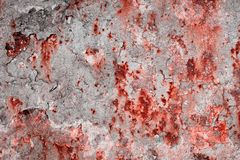 Rusty metal surface with spots of bloody color Stock Photography