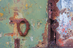 Rusty metal surfaces with  a horseshoe Royalty Free Stock Photography