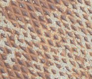 Rusty metal texture with gravel triangles Royalty Free Stock Image