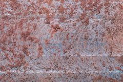Rusty metal texture macro background. The metal texture is covered with a layer of rust. Metal background royalty free stock photo