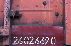 Rusty metal texture. With white numbers Royalty Free Stock Image