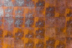 Rusty metal tile wall. steel iron wallpaper for industrial texture pattern. Background Royalty Free Stock Photo