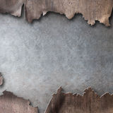 Rusty metal with torn hole steam punk background Royalty Free Stock Photos