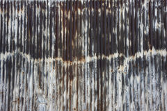 Rusty metal wall. Which used to be painted white Royalty Free Stock Photography