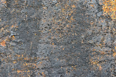 Rusty metal wall as a gloomy background Stock Image