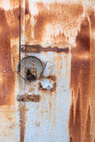 Rusty metal wall and door with the lock. Old rusty metal wall and door with the lock Royalty Free Stock Image