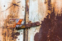 Rusty metal wall and door with peeling paint. Abstract. Royalty Free Stock Images