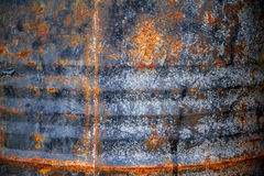 Rusty metal wall is a wall of an old oil tank Stock Photos