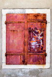 Rusty metal window. All covered in shades of red Stock Photos