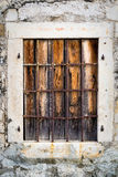 Rusty metal window with bars Stock Photos