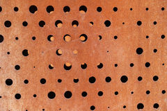 Rusty metallic background with holes Royalty Free Stock Images