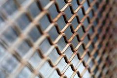 Rusty metallic net. Short depth-of-field Royalty Free Stock Photo