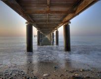 Rusty metallic  pier from sea level Stock Photo