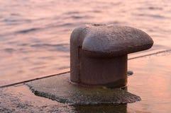 Rusty mooring bollard closeup Stock Images