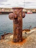 Rusty mooring bollard in Iceland Royalty Free Stock Photography
