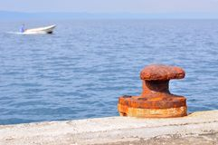 Rusty mooring bollard on port of Podgora Stock Images