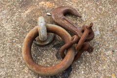 Rusty mooring hook for boat on concrete stock photos