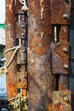 Rusty mooring post. On the pier still in use Royalty Free Stock Image