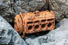 Rusty motor in the rocks Royalty Free Stock Photos