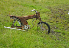Rusty Motorbike. Rusty and deserted old motorbike laef abandoned in a field Stock Image