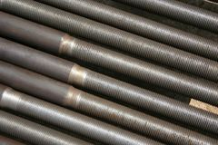 Rusted ms steel pipes diagonally arranged. Rusty MS Steel Pipes kept at a factory for fabrication. useful for textures and backgrounds Royalty Free Stock Image