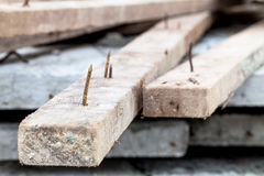 Rusty nail. Sharp rusty nail stick on wood royalty free stock image