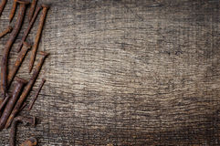 Rusty nails  in the background of the old wooden. Rusty nails on the side in the background of the old wooden cracked Royalty Free Stock Photos