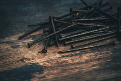 Free Rusty Nails Macro On The Wooden Background, Toned Stock Photos - 117892413