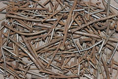 Rusty nails. Macroshot of old used and rusty nails, curved nails, different dimensions, close up Stock Images