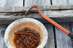 Rusty nails and nail puller Royalty Free Stock Photo