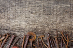 Rusty nails on  old wood background Royalty Free Stock Images