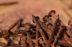 Rusty nails. On a rusted surface Royalty Free Stock Photo