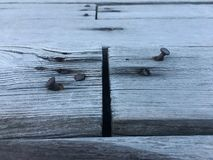 Rusty nails stick in wooden plank for joint two board together. stock photography