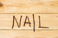 Rusty nails on the wooden table Stock Photo