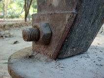Rusty nut bolt close up. Close up of rusty nut bolt fixed on metal and wood stock image