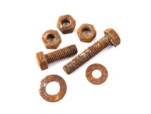 Rusty nuts and bolts. On a plain white background Stock Image