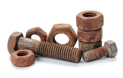 Rusty nuts and bolts on white. Background Stock Images