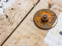 Rusty nuts on wood Stock Photography