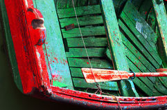 Rusty oars in an old wooden boat. With vivid colors Stock Images