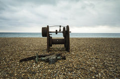 Rusty objest on a seashore Royalty Free Stock Photos