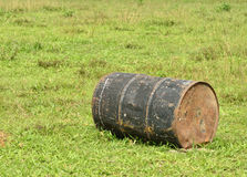 Rusty oil barrel. On grass field Royalty Free Stock Photos