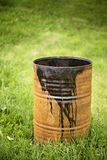 Rusty oil barrel on green grass. Royalty Free Stock Photography