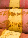 Rusty oil barrels yellow red background pattern Royalty Free Stock Images