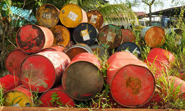 Rusty oil drums near junkyard Royalty Free Stock Images