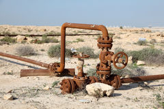 Rusty oil pipes in the desert stock photos