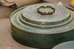 Rusty old anti-tank mine or AT mine, a type of land mine designed to damage or destroy vehicles including tanks and armored fight. Ing vehicles royalty free stock photography