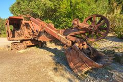 A rusty old backhoe, or excavator, left out in nature stock image