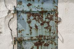 Rusty old blue door with cracked wall, abstract and textured background royalty free stock photos